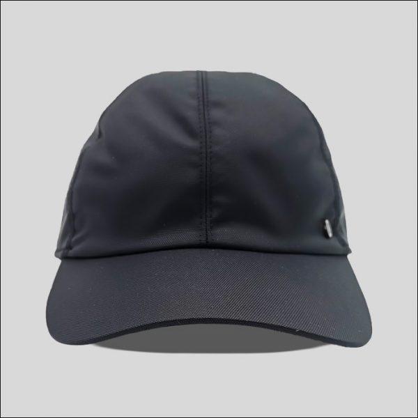Cappello con visiera in tessuto